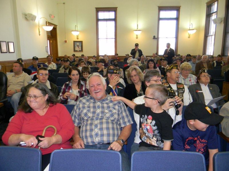 Group picture of people in Court house, sitting in rows
